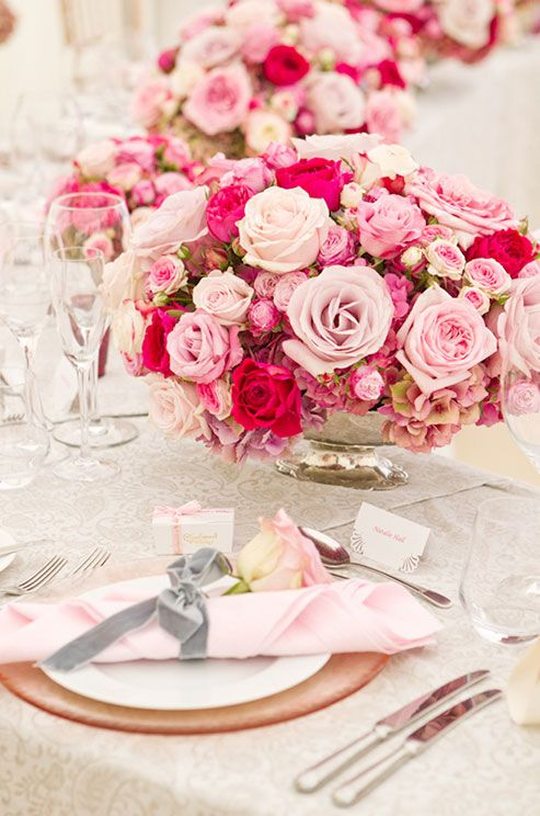 Mesmerize guests by lining a table with multiples of a romantic floral arrangement.