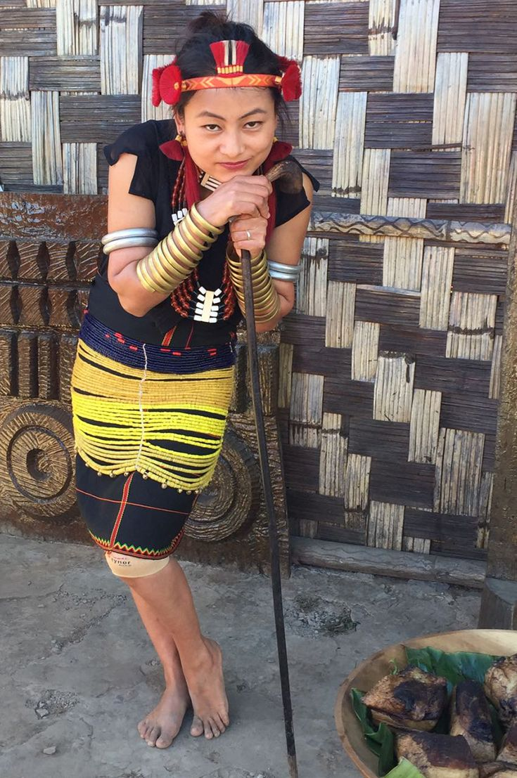 Sumi girl with beaded yellow skirt at the Hornbill Festival, Nagaland, North East india