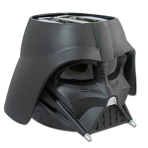 """""""Luke, I am your toaster. The empire strikes back with deliciously toasted bread, waffles and English muffins courtesy of the Star Wars Darth Vader Toaster. This sleek, all-black exterior toaster imprints the Star Wars logo on every slice."""