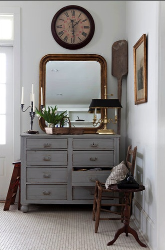 Everything in this corner works - the oar, old, wall clock and painted grey dresser...