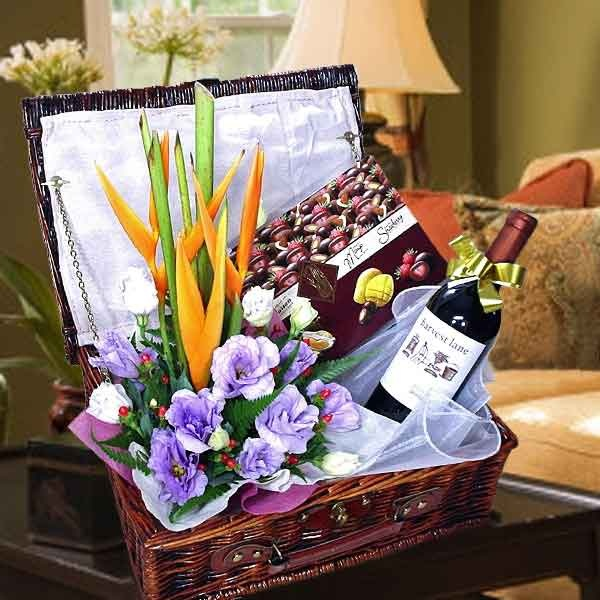 Bottle of Red Wine with Chocolates and Flower Arrangement