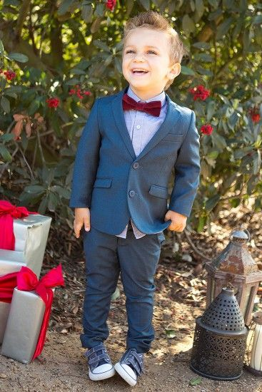 This   chic suit is a throwback to fashion from another era, with slim fit pants, a   sharp grey button down, and a jacket with two button accents.  Add a little maroon bow tie, and the outfit   is complete for any holiday affair. By Appaman.