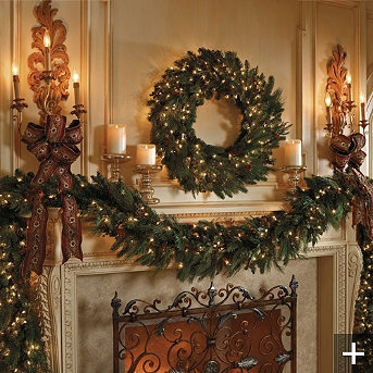 Holiday mantle with greenery and wreath