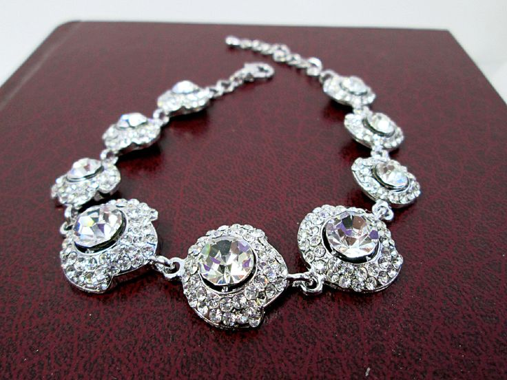 A personal favorite from my Etsy shop https://www.etsy.com/ca/listing/278098586/silver-crystal-statement-bracelet