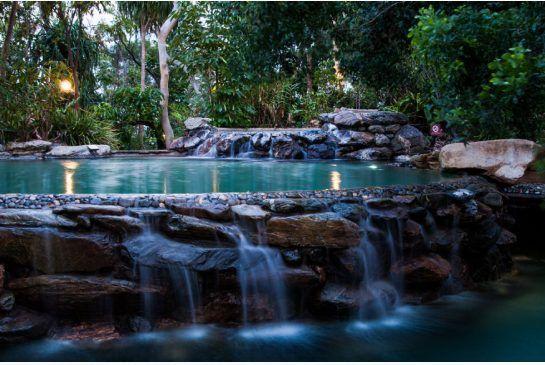Thala Beach Lodge uses cloaking rocks to give their pool the look of a jungle swimming hole. Thala Beach Resort www.greengetawaysaustralia.com.au