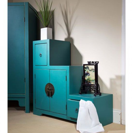 Here's a step storage #cabinet giving proper usage and providing base tops for displaying #antiques. The Anji 2 step storage cabinet comes in teal color and features one large and 2 small cupboards.