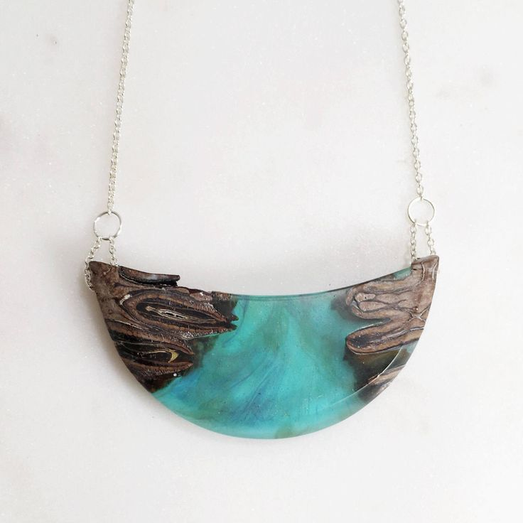 A personal favorite from my Etsy shop https://www.etsy.com/ca/listing/517659713/teal-resin-wood-pendant-necklace-teal