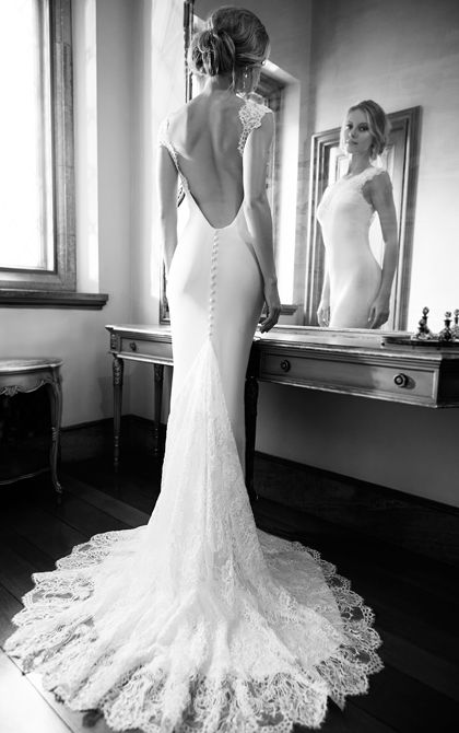Martina Liana wedding dress featuring a sweetheart Lace illusion neckline, cap sleeves and cascading train made from rich Silk Moroccan with a low back. #MartinaLiana #WeddingDress