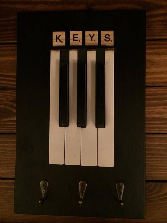 Key Holder Made From Old Piano Keys That Have Been Mounted On A