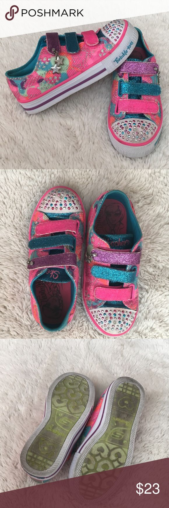 Twinkle Toe Skechers light up shoes for girls! Twinkle Toe Skechers light up shoes for girls! Size 13. Only worn a few times. A few rhinestones are missing other than that they are in very good condition! Skechers Shoes Sneakers