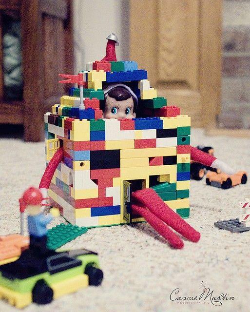 elf on a shelf ideas - hiding in a house of legos too funny