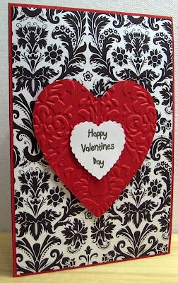 handmade valentine from Jenfa Cards ... luv the graphic feel with strong red, black and white ... like the detail of matching the embossing to the printed pattern of the background layer ...
