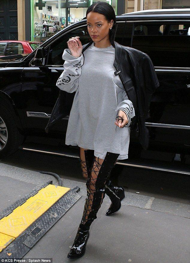 Rihanna rocks a pair of kinky boots for Puma shoot in Paris