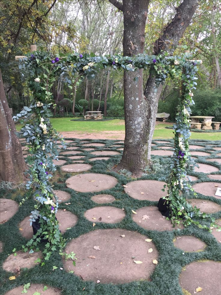 A beautiful arch just makes an outdoor ceremony. Designed by Bliss Floral Creations