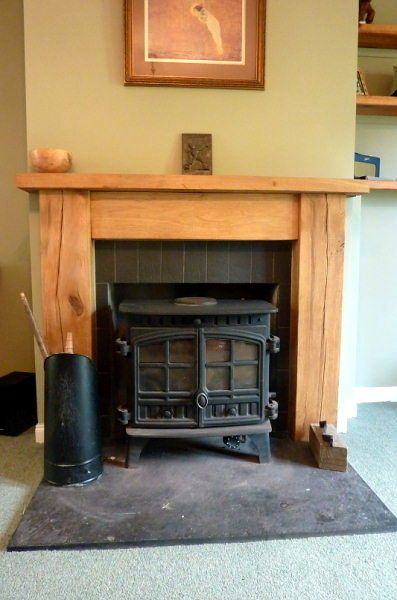 Solid English oak fire surround. By www.harrisonwoodwork.com