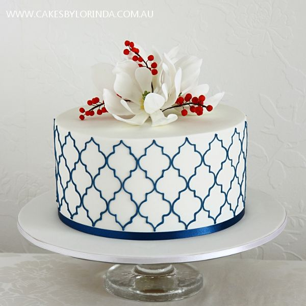 i love to see how people make a small one-tier cake make a BIG statement.  this one rocks.  cakes by lorinda