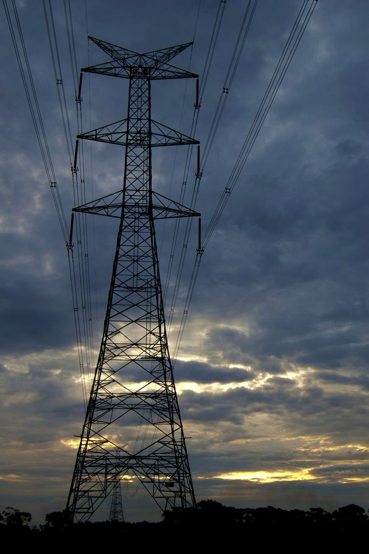 Powerlines near dusk amid burning off stubble and uncooperative clouds