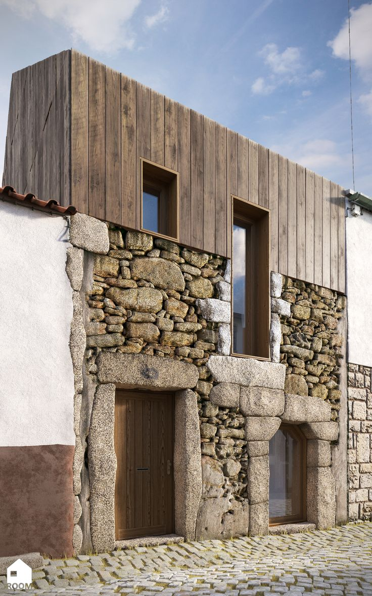mix of modern panelling and rustic stone contrasting new and old