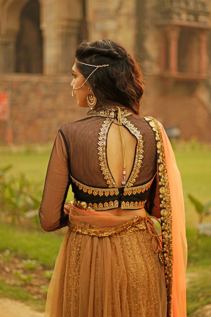 Indian Blouses - Black Net Blouse with Slit | WedMeGood | Black and Peach Lehenga with Black Net Blouse and Middle Slit, Gold and Peach Embroidery #wedmegod #choli #lehenga #indianwedding #indianbride #blouse #slit #peach
