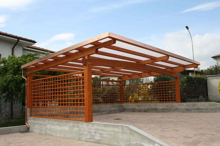 This modern wooden carport is design like a bee hive, unless this is rectangular.
