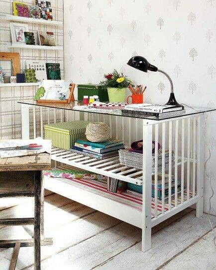 Repurposed crib - I would add a butcher block top and use it as a kitchen island.