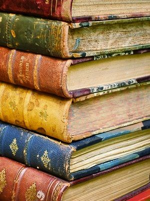 My inner Belle dreams of bookshelves filled with thousands of beautiful hard bound books like these...