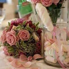 Gorgeous and fun wedding table centerpiece.. Unique fucsia and pink floral centerpiece.. a touch of marshmallows Floral work: Corflor wedding florists