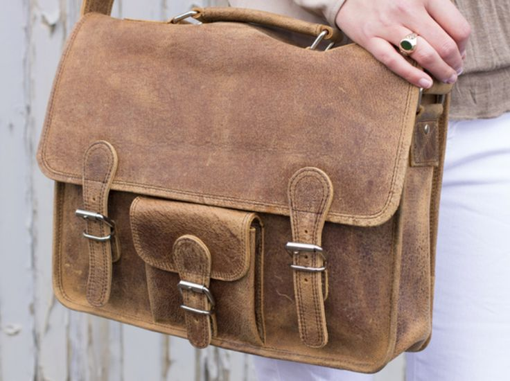 Inspired by the classic old brown school leather satchel, Scaramanga's cross-body women's satchels are ideal for girls who want a practical but stylish leather bag with space for all their day-to-day stuff without looking bulky. #leather #leatherbag #giftsforher