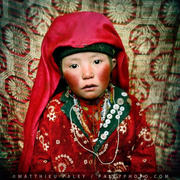 Photo by @paleyphoto (Matthieu Paley - National Geographic Photographer)  No, it's not make-up, and it's not retouched. Her cheeks burned by the bitter cold, Marbet, a 7-year old Kyrgyz girl, just returned from gathering the yak herd in her camp, in the middle of winter. With an estimated 50% child mortality rate, life is harsh up at 14.000 feet in the Pamir mountains of Afghanistan.