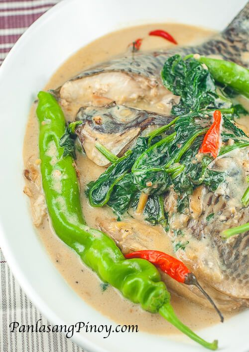 Ginataang Tilapia pertains to tilapia cooked in coconut cream and sauteed garlic, onion and ginger with spinach and long green chili.