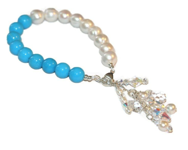 Make a statement with this show stopping Bracelet.  Fresh Water Pearls, Shell, swarovski crystals. Handmade by Redki - Wearable Art Made in Australia www.redki.com.au