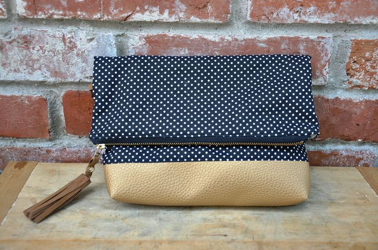 Foldover dotted clutch with golden line