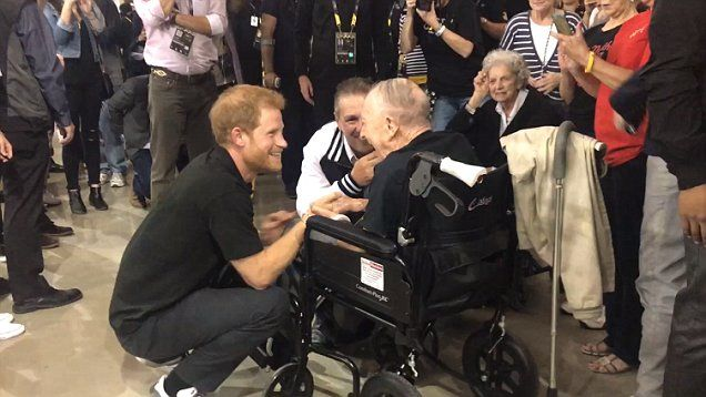 Prince Harry chats with101-year-old WW2 veteran Sgt James Norman Baker who movingly thanked him for bringing the Invictus Games to Canada.