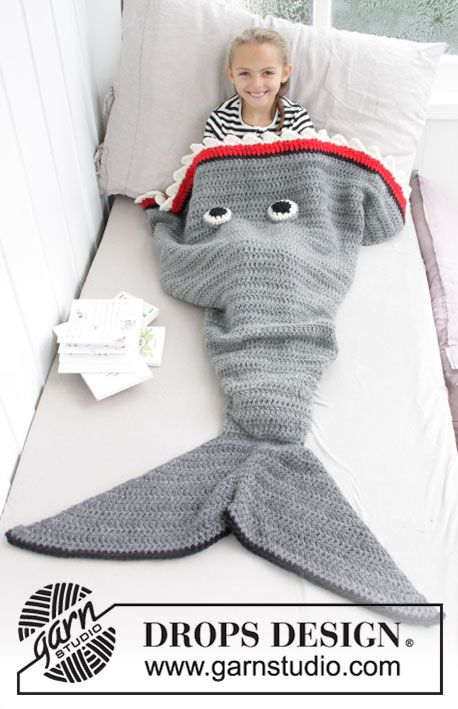 Shark Attack Blanket - Crocheted shark blanket for kids. Size 3-14 years Piece is crochet in DROPS Eskimo. Free crochet pattern DROPS Children 28-13