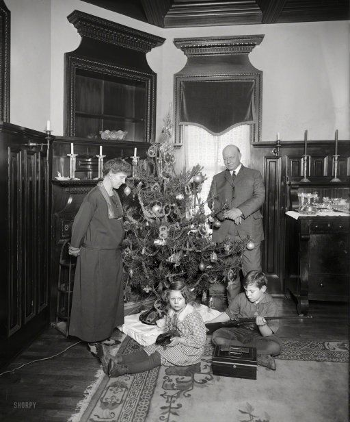"""Washington, D.C., circa 1922. """"Denby Christmas tree."""" Junior remembers this as the best Christmas ever! His gun-giving dad is Secretary of the Navy Edwin Denby."""