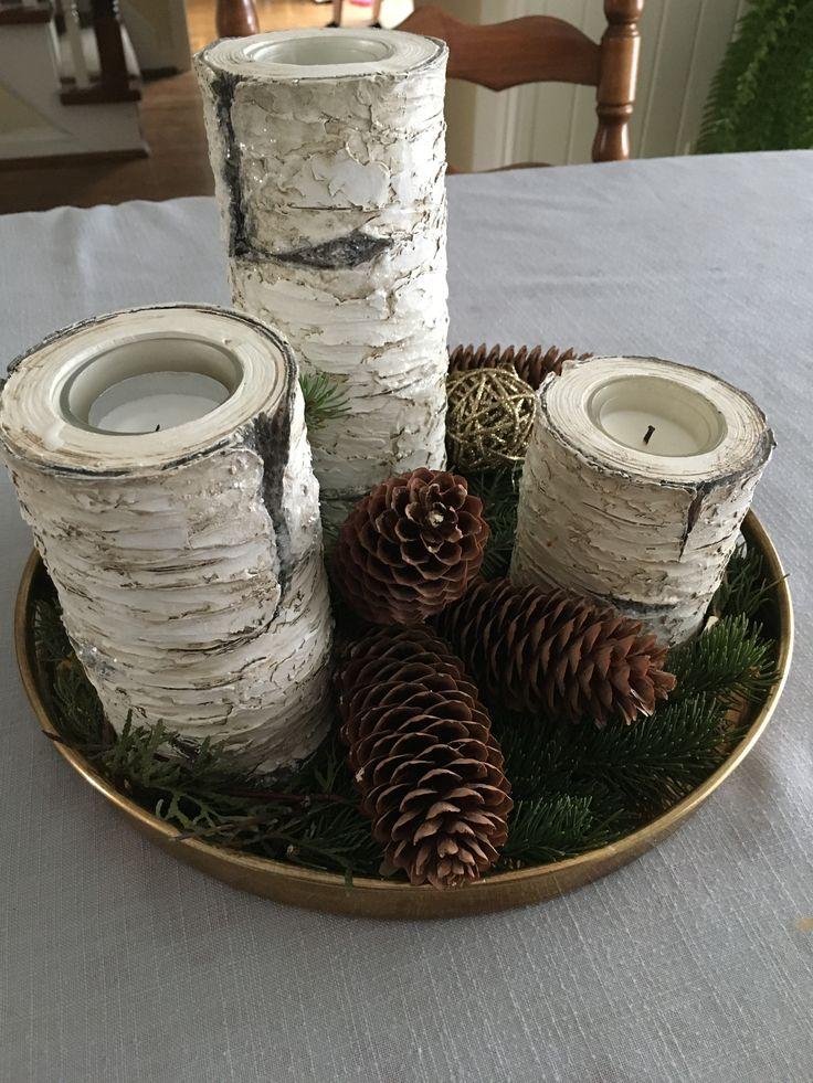Birch bark candles, pine cones, greenery, brass tray