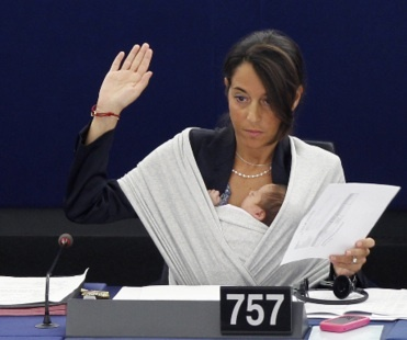 Mrs Ronzulli, an MEP from Italy, took her tiny daughter Victoria to a vote  at Strasbourg. She kept her baby carefully cradled against her in a  sling and occasionally leant to kiss her on the forehead. This is how we need to support working mothers and fathers. You should never have to choose between your career and having a family.  Do work, mama.