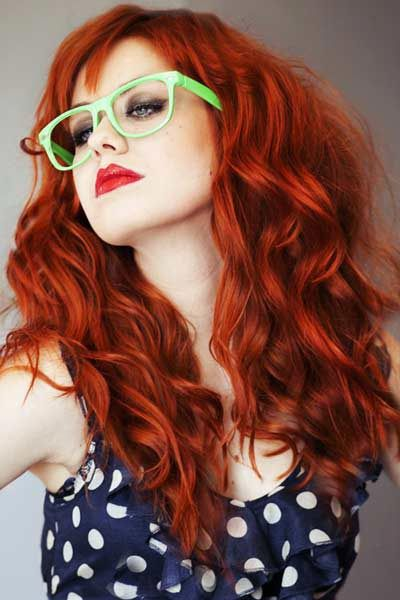 Get some edge to your hairstyle – bold colour and straight bangs with curly hair.   beautiful#haircolor#redhead