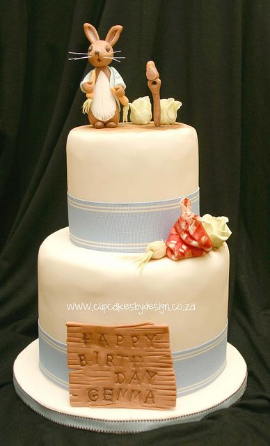 Peter Rabbit Cake - i like this simple looking cake but with burlap instead of the blue. We can use the figures I already have