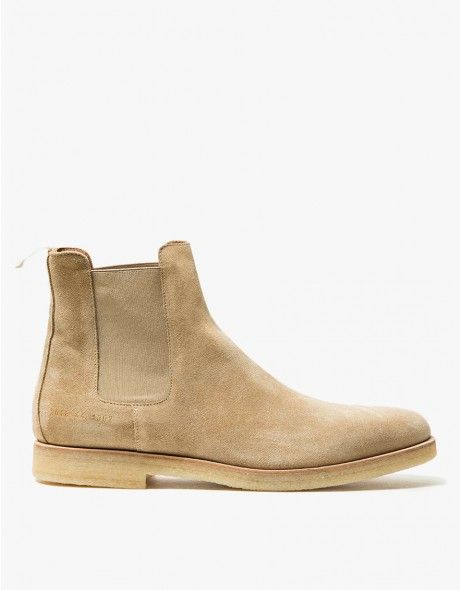 Classic chelsea boot from Common Projects in Sand. Suede upper. Almond toe. Pull-on design. Tonal elastic goring at ankle. Off-white grosgrain pull tab. Tonal stitching. Subtle heat pressed gold serial number detail at lateral side. Lined.  • Leather up