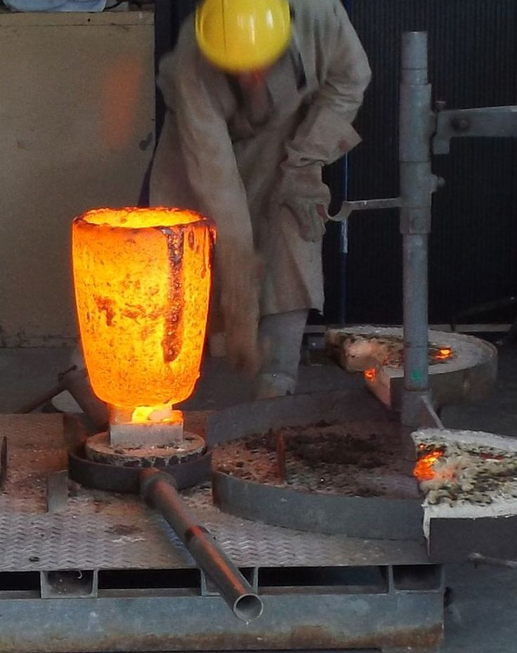 Preparation for a bronze pour at the Foundry, Strathnairn Arts, 30 Sept 2014.