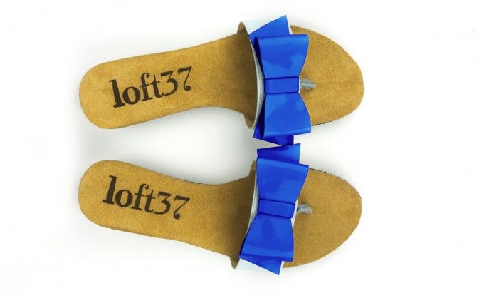 Flip-flops decorated with a bow in sapphire color. Perfect shoes for summer holidays!