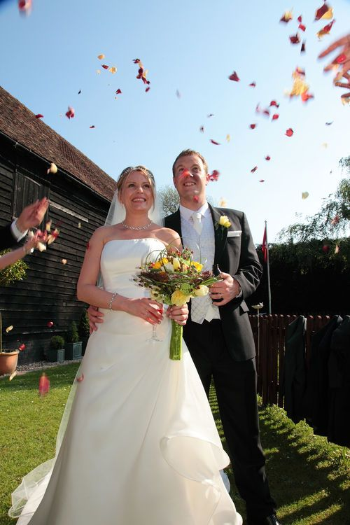 Throwing confetti over the bride and groom at Winters Barns in Kent