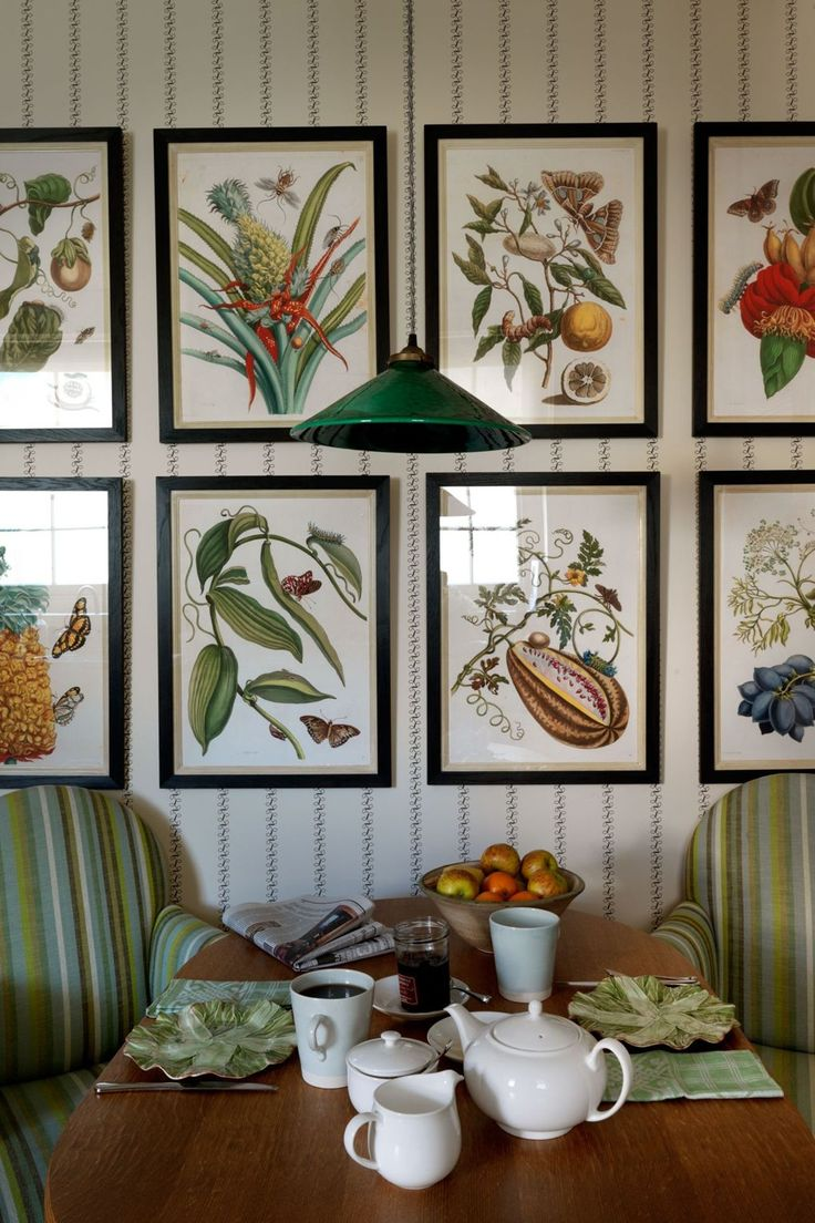 Pretty botanical pictures, hung in symmetrical rows, gently bring out the green accents in the upholstery. If you like the look of these, check out the 'Hubbard Flower Grid' by Natural Curiosities. A mix and match collection of 120 different flower illustrations by Cyril E.B. Hubbard.