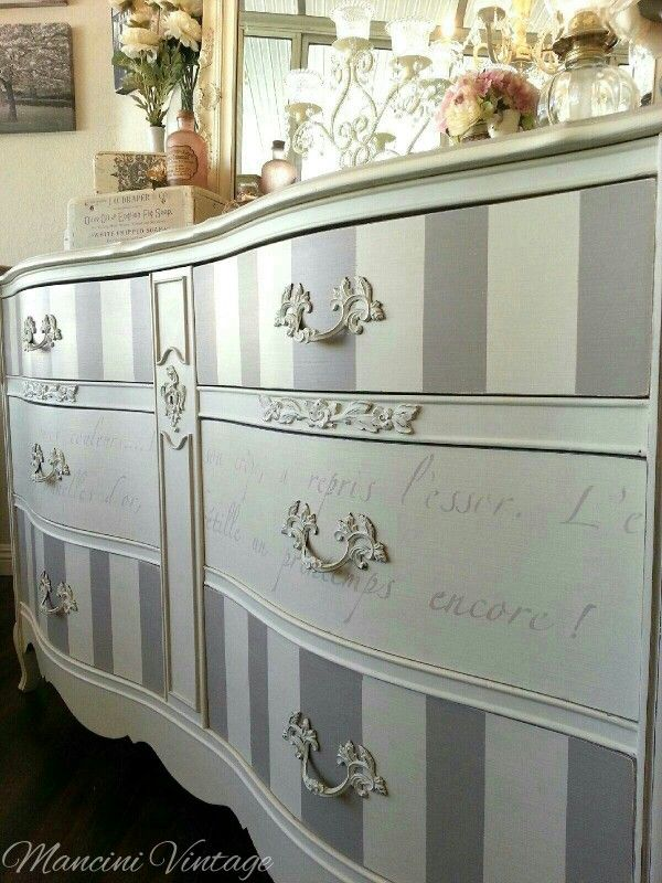 DIY Idea - Stripes on the drawers and words painted on the middle drawers.