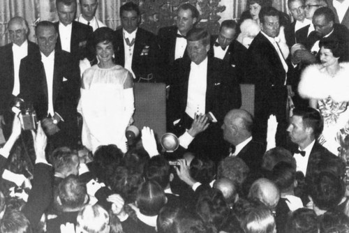 President Kennedy reaches down to shake hands with a zealous guest at the Inauguration Ball held at the Mayflower Hotel ~ Jan. 20th, 1961