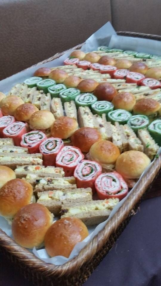 Mini sandwiches Prawn Louis brioche rolls Curried chicken salad on rye fingers Turkey, arugula and cranberry cream cheese pinwheels