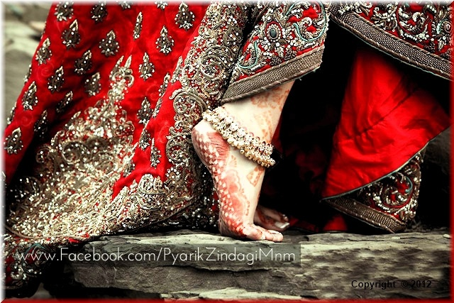 red lehnga and gold payal