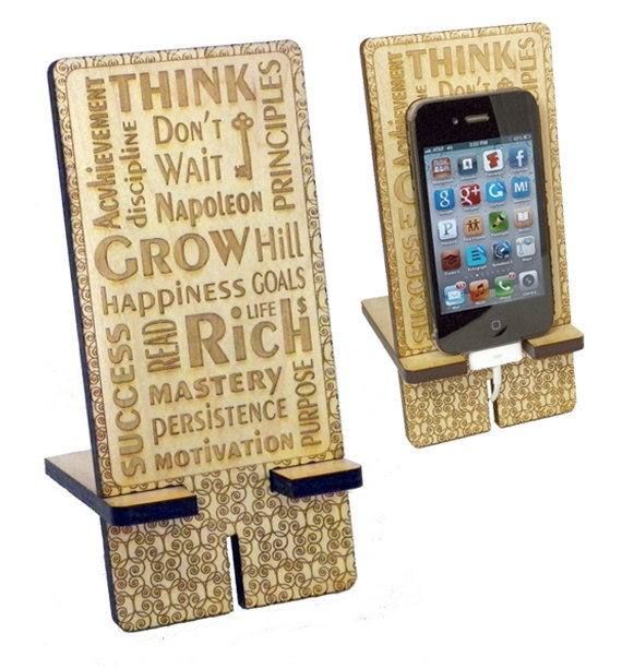 Think and Grow Rich iPhone Stand Charging Station. Word Art Laser Engraved on Maple Wood. $19.00, via Etsy.