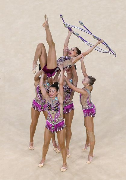 The Uzbekistan team compete in the Women's group allaround qualifying event of…